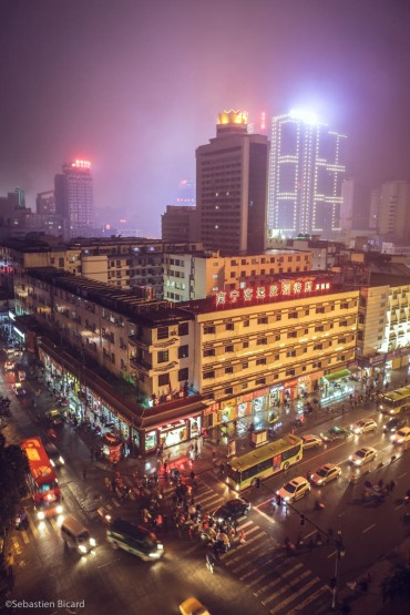 Neon lights up the misty Guangxi capital of Nanning, China. February 2014.