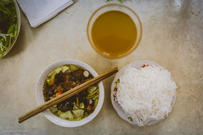 Bun cha, green tea and rice noodles for lunch in Hanoi.