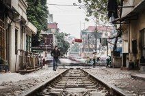 Train tracks running through densely populated neighborhoods in Hanoi, Vietnam. February 2014.