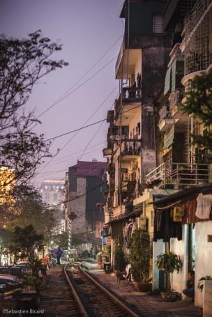 Train tracks in Hanoi's urban neighborhoods, Vietnam. February 2014.