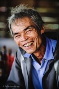 A local pineapple farmer takes a coffee break in a roadside stand. Vietnam, March 2014.