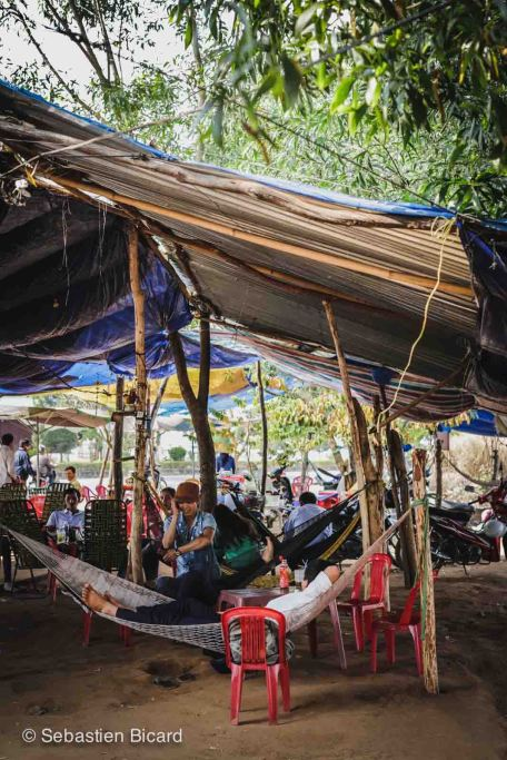 A streetside café offers not only refreshments like sugar cane juice and Vietnamese coffee, but also plenty of comfortable hammocks for a real break.