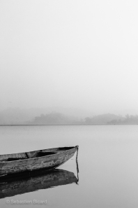 Canoe and mist on Halong Bay. Vietnam, March 2014.