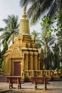 Brightly gilded golden shrine near a wat in Battambang, Cambodia, March 2014.