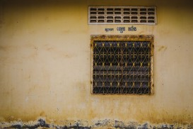 A decorative window grate on a wat, or temple. Battambang, Cambodia, March 2014.