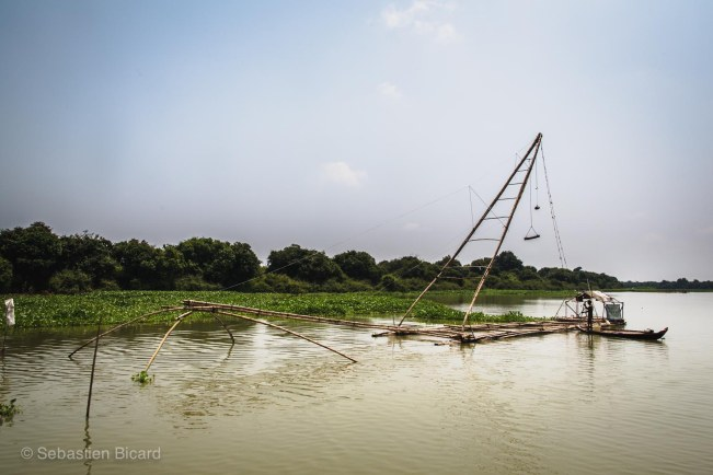 A bamboo cantilever fishing net: a large square net stays immersed in the river for several hours. It will be hoisted up later (hopefully) full of fish for dinner.