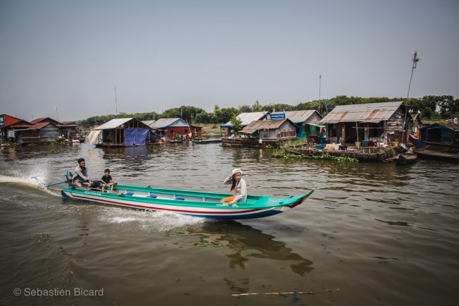 Small canoes with outboard engines serve as water taxis for locals crossing the river or navigating between villages.