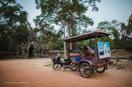 A tuk-tuk driver waits patiently as his riders explore the thousand-year-old temples. Angkor, Cambodia, March 2014.