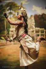 A dancer recreates the familiar positions of traditional Apsara dance. Siem Reap, Cambodia, March 2014.