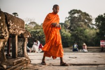 The distinctive orange robes of a monk near Angkor Wat. Cambodia, March 2014.
