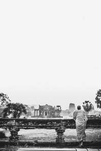 A Buddhist monk contemplates the sunset view from Angkor Wat. Cambodia, March 2014.