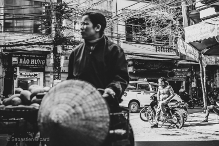 Street scene of the Old Quarter in Hanoi. Vietnam, February 2014.