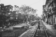 The incredible railroad track runs through Hanoi within feet of buildings and homes. Vietnam, February 2014.