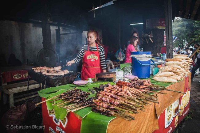 Grilled bits of pork, fish and chicken at the morning market.