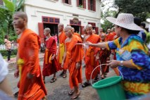 The monks and novices get a gentle watering down during the parade.