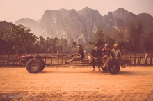 A slow but powerful tractor ferries young men from village to village. Kong Lo, Laos, April 2014.