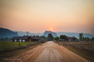 A dramatic sunset over karst formations outside Kong Lo village, Laos, April 2014.
