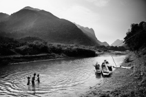 Local children play and bathe in the early evening. Muang Ngoi, Laos, April 2014.