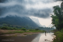 Low hanging clouds block the mountain view on an early morning in Muang Ngoi, Laos, April 2014.