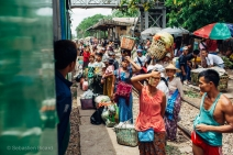 Passengers and produce wait to board Yangon's Circular Train in an outlying suburb. Myanmar, May 2014.