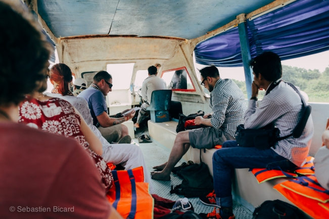 If it appears in Lonely Planet, be sure that you'll see some fellow backpackers. Here, on the slow boat to Siem Reap.