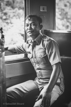 A customs official takes the break on the only train in Laos. Thanaleng, Laos, April 2014.