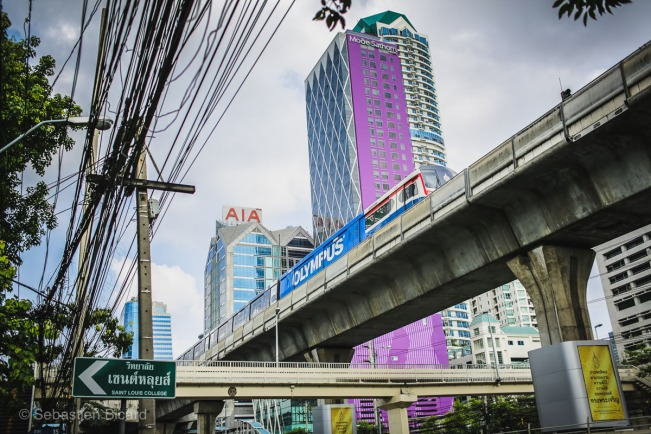 The Skytrain passes by some skycrapers in central Bangkok.