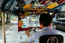 A tuk-tuk driver weaves in and out of the congested traffic in Bangkok. Thailand, April 2014.