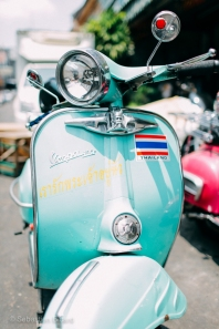 Motorbikes and vintage mopeds make for good transportation options in the capital. Bangkok, Thailand, April 2014.