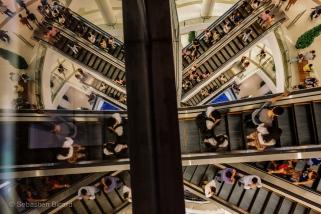The impressive escalators in Siam Paragon shopping center in Bangkok. Thailand, April 2014.