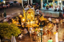 The surprising Erawan shrine glows golden amid the rush of traffic in downtown Bangkok. Thailand, April 2014.