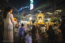 Hindu devotees come to worship day and night at Erawan Shrine. Bangkok, Thailand, April 2014.