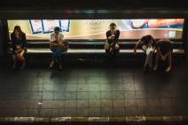 Passengers wait at a bus stop in Bangkok. Thailand, April 2014.