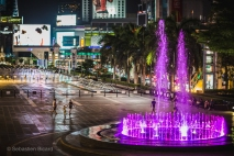 The glowing colored fountain in front of Central World shopping center in Bangkok. Thailand, April 2014.