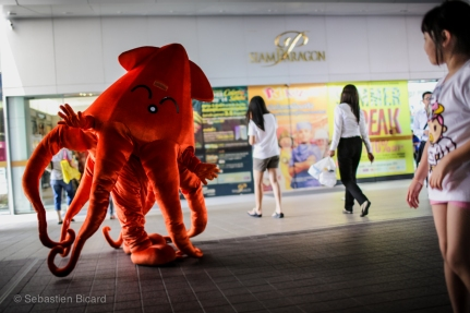 An octopus hands out coupons for a deal in Siam Paragon shopping center. Bangkok, Thailand, April 2014.