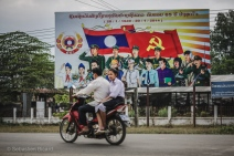 Communist propaganda billboard along the roadsides on the Bolaven Plateau. Laos, March 2014.