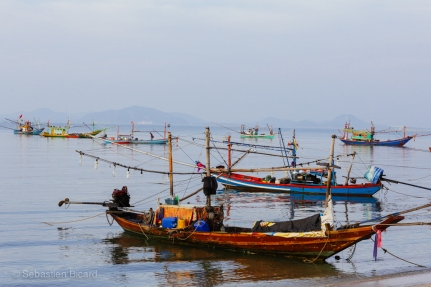 Moored boats in the ferry harbor of Chumphon in the Gulf of Thailand. April 2014.