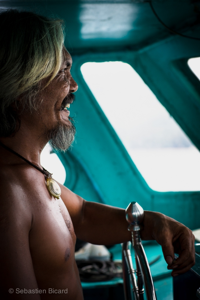 The eccentric and friendly dive boat captain takes us out to sea for a scuba session. Koh Tao, Thailand, May 2014.