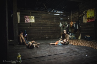 A peaceful evening with multiple generations in a village homestay. Ban Phon Kham, Laos, April 2014.