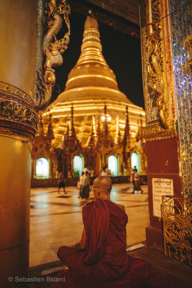 Shwedagon Pagoda in Yangon is one of the most sacred religious sites for Burmese Buddhists. Myanmar, May 2014.