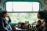 A family rides the slow train from Yangon to Pyay. The children were incredibly patient during the 12 hour journey. Myanmar, May 2014.
