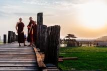 Monks enjoy their sunset walk on U Bein Bridge, the longest and oldest teakwood bridge in the world, just outside Mandalay. Myanmar, May 2014.