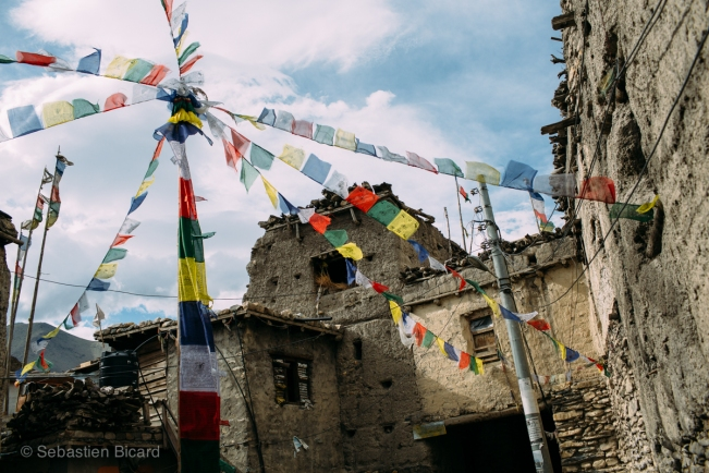 Clay homes and colorful prayer flags showed the overwhelming majority of Tibetan culture in this part of Nepal.