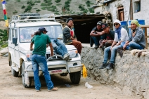 Young men gather near the village restaurant for a hearty lunch of dal bhat (lentils and rice). Upper Mustang, Nepal, July 2014.