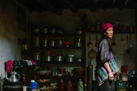 A Tibetan village woman prepares salted butter tea in her mud hut. Upper Mustang, Nepal, July 2014.