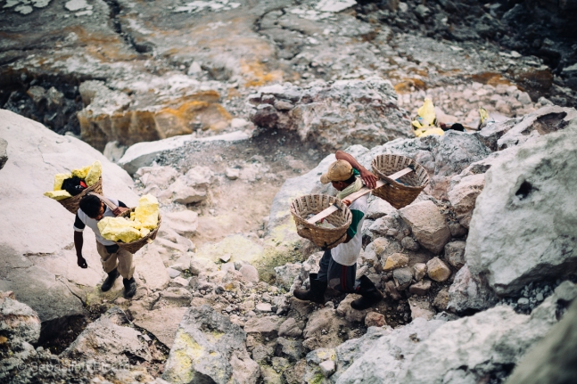 The handmade baskets supported by a sturdy bamboo is the only equipment needed to carry the heavy loads of sulphur out of the crater. Java, Indonesia, June 2014.