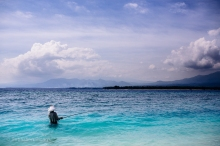 A fisherman tries his luck in some of the magnificent blues we saw off the coast of Gili Air. Indonesia, June 2014.