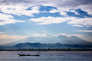 Mount Rinjani peeks through the clouds on Lombok as we enjoy our breakfast on Gili Meno. Indonesia, June 2014.