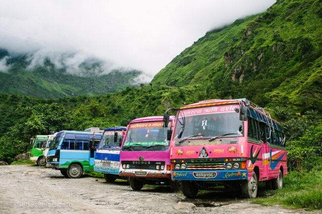 The bus station in Ghasa shows the old but colorful buses waiting to shuttle locals between villages.