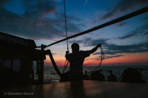Evening duties on the Lombo dive boat with a 360° view of the sunset. Indonesia, June 2014.